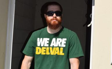 "An alumni wearing a ""We Are DelVal shirt"""