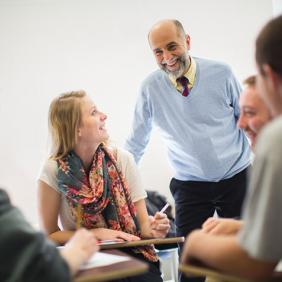 Dr. Tony La Salle, a professor in Delaware Valley University's Department of Education, teaches a small group of students who are taking notes.