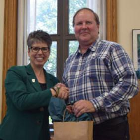 DelVal President Dr. Maria Gallo shakes hands with Robert Brown, a faculty member and alumnus of the University.
