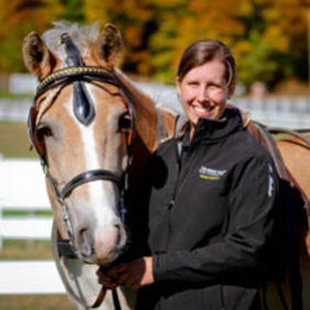 Department of Equine Science and Management Instructor Katie Kashner stands next to a horse.