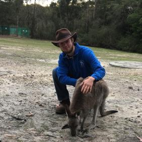 Christian Anderson, a Delaware Valley University student with a kangaroo.