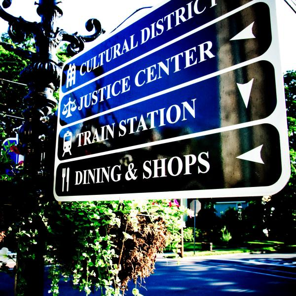 A sign guiding people to different locations in Doylestown