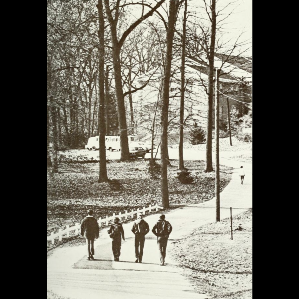 Students from 1970's walking up a farm road