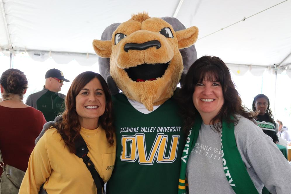 Two alums with Del Val mascot.