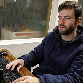 A student looking at a computer
