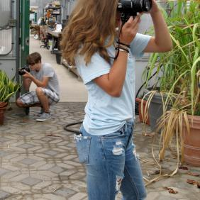 A female student taking a photo.