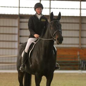 Student riding in dressage competition