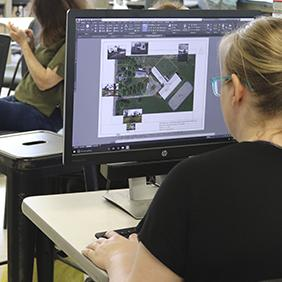 A student working on a site plan on a computer