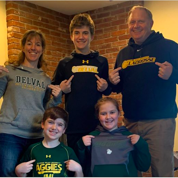 Stephanie '99 and Patrick Callahan '99 having DelVal spirit day at home