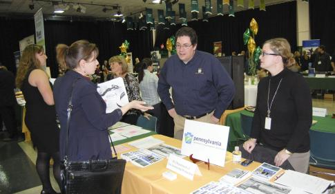 Student talking to possible employer at career fair