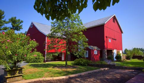 A large red barn on the DelVal campus.