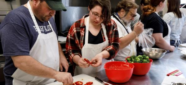 Students preparing bell peppers
