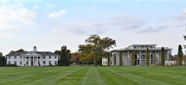 The quad at DelVal: a lush green field with two buildings.
